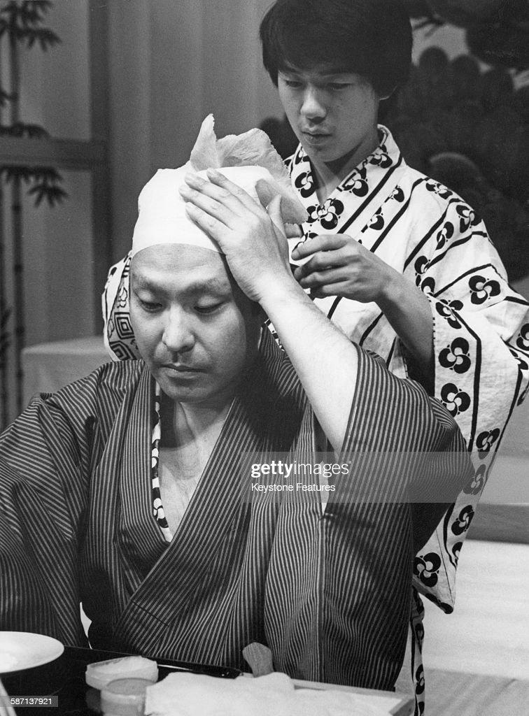 Japanese Kabuki actor Ichikawa Ennosuke III dons his costume for a dress rehearsal at Sadler's Wells in London UK October 1981