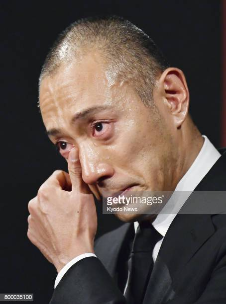 Japanese kabuki star Ichikawa Ebizo wipes away tears during a press conference in Tokyo on June 23 after his wife Mao Kobayashi a 34yearold Japanese...