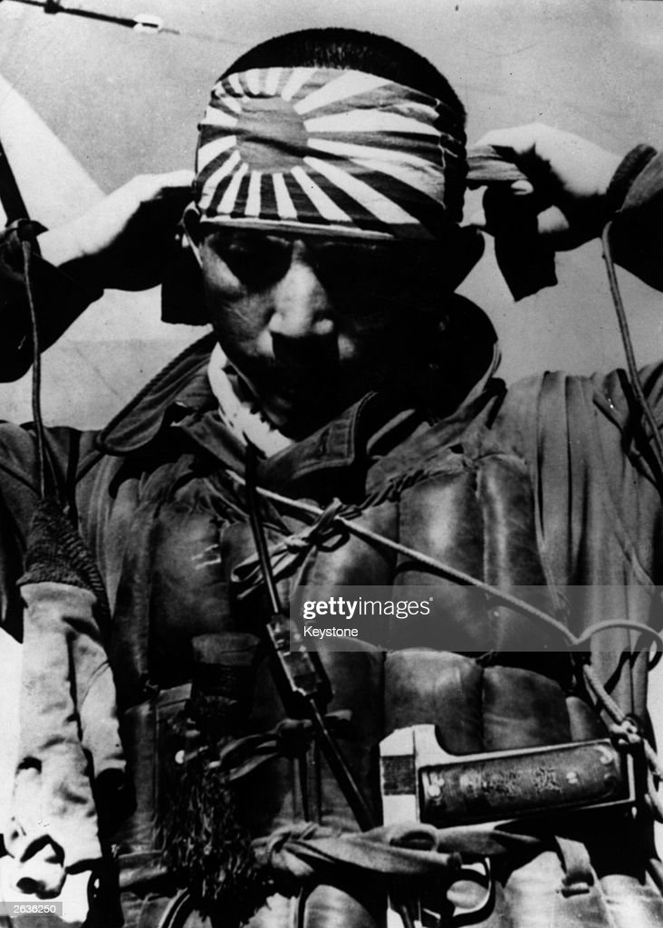 A Japanese kamikaze pilot tying on the honorary ribbons that were always worn when on a suicide mission 'Kamikaze' which means 'winds of the gods'...