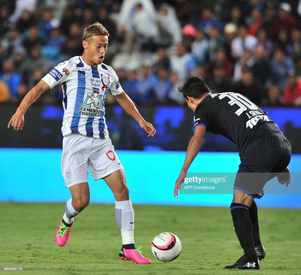 Japanese Keisuke Honda L of Pachuca vies for the ball with