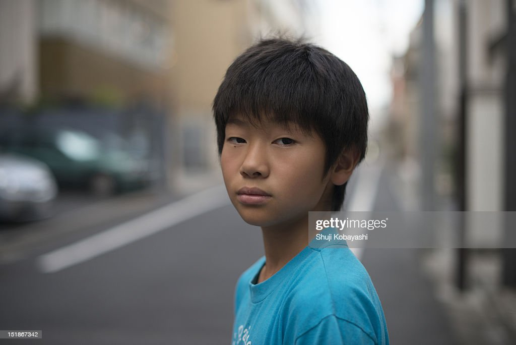 Japanese kid on the street looking at the camera : Stock Photo