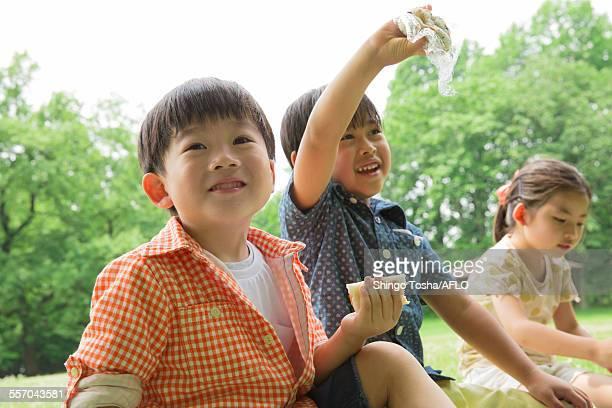 Japanese kids having picnic in a park