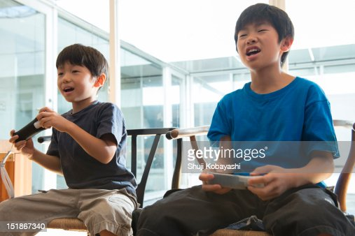 Japanese kids playing a video game : Stock Photo