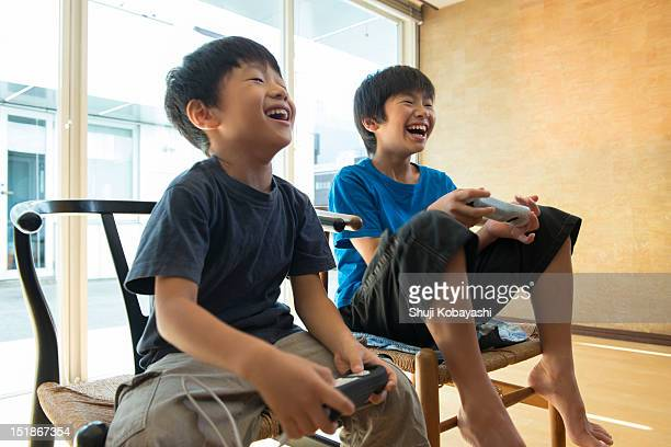 Japanese kids playing a video game