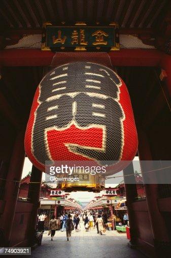 Japanese lantern hanging on the gate at a temple, Kaminarimon Gate, Asakusa Kannon Temple, Asakusa, Tokyo Prefecture, Japan