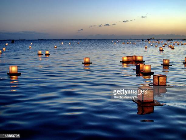 Japanese lanterns floating on ocean