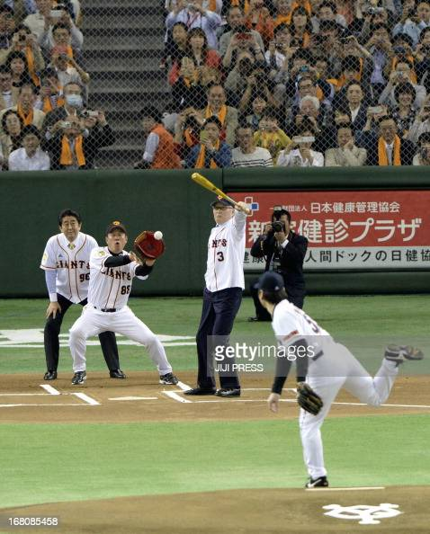 Japanese legendary slugger Shigeo Nagashima swings at a pitch from former Yomiuri Giants and New York Yankees slugger Hideki Matsui as current...