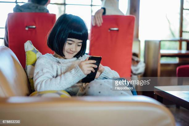 Japanese little girl using smartphone