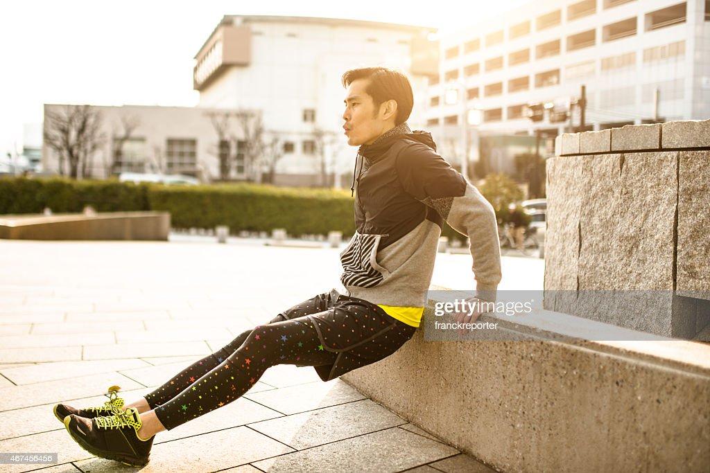 Japanese man doing push-ups