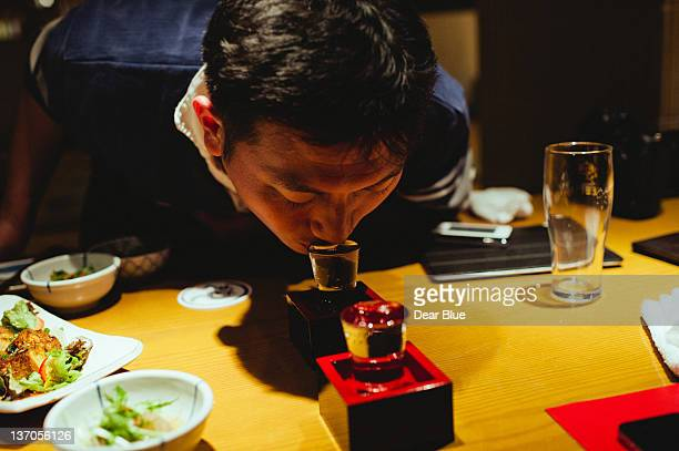 Japanese man drinking traditionally