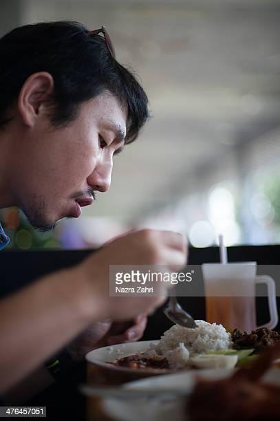 Japanese man eating nasi lemak