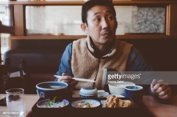Japanese man having Japanese lunch at a restaurant
