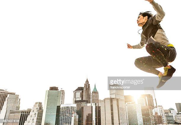 Japanese man jumping high against the skyline