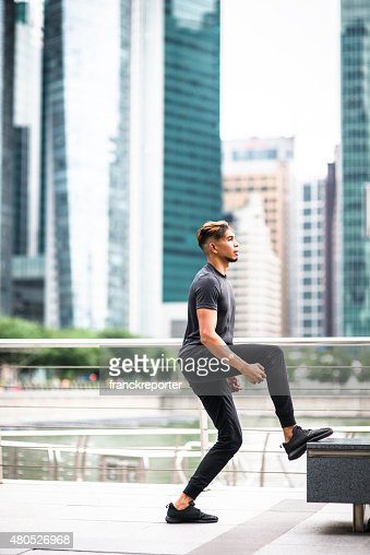 Japanese man jumping high on the city of Singapore : Stock Photo