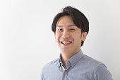 Japanese man looking at camera