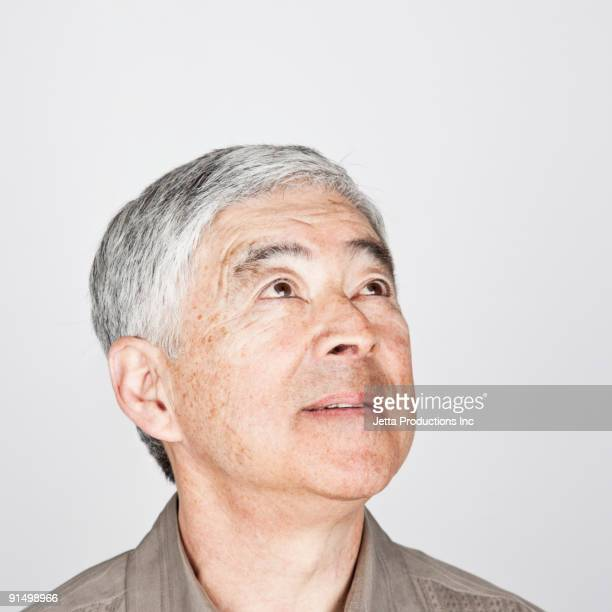 Japanese man looking up