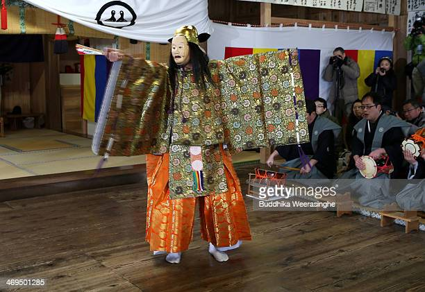 Japanese man performs noh during the annual Mizumi Dengaku and Noh performance at Uama Shrine on February 15 2014 in Fukui Noh actors dressed in...