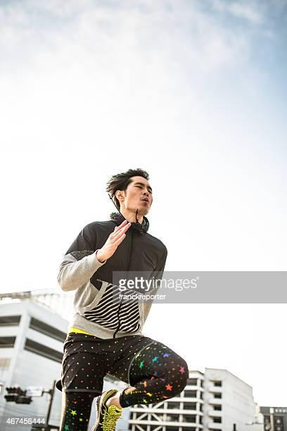 Japanese man running on the city