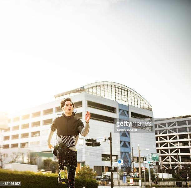 Japanese man running on the city