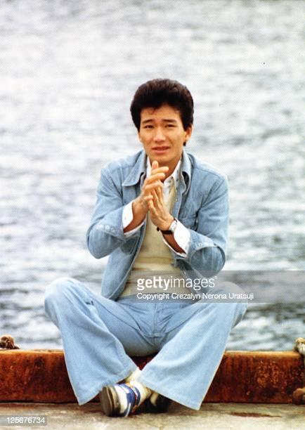 Japanese man sitting in lakeside