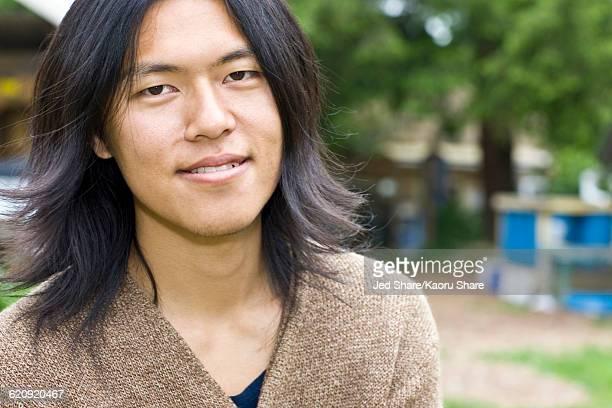 Japanese man smiling outdoors