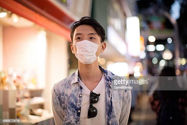 Japanese man wearing protective mask in Tokyo