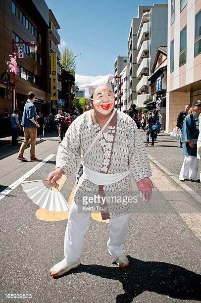 Japanese man wears a face mask as he parades through the streets at Kanamara Matsuri on April 7 2013 in Kawasaki Japan The festival is held annually...