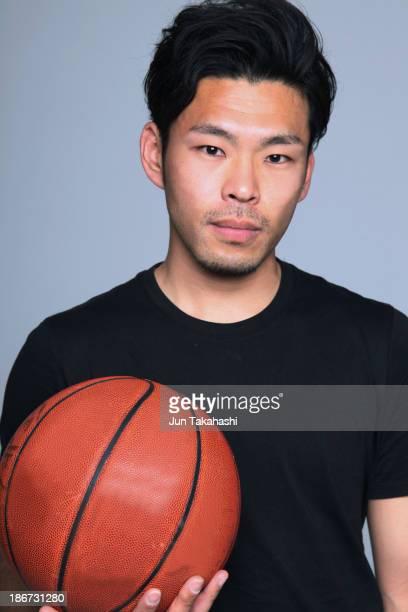 Japanese man with basketball