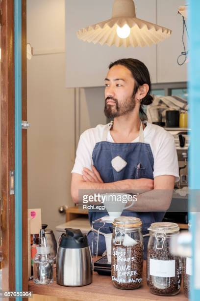 Japanese man working in a cupcake shop