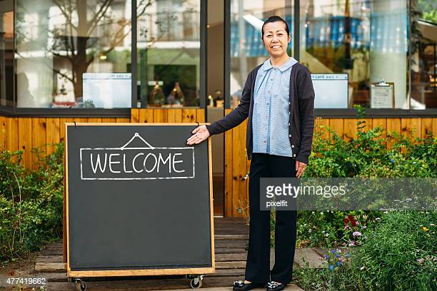 Japanese manager in front of coffee shop