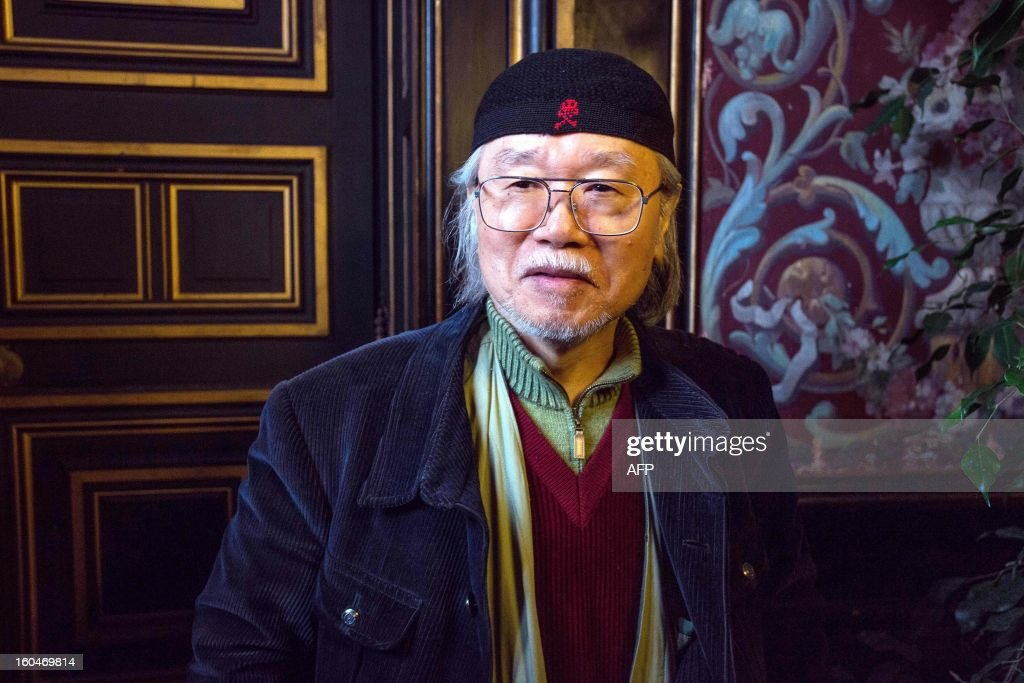 Japanese mangaka Leiji Matsumoto poses on February 1, 2013 during the 40th Festival International de la Bande Dessinée (Angoulene's international comic books festival) in Angouleme, western France. Matsumoto, famous for his series Captain Harlock and Galaxy Express 999, celebrate his 60 years of carreer as the festival's guest of honour today.