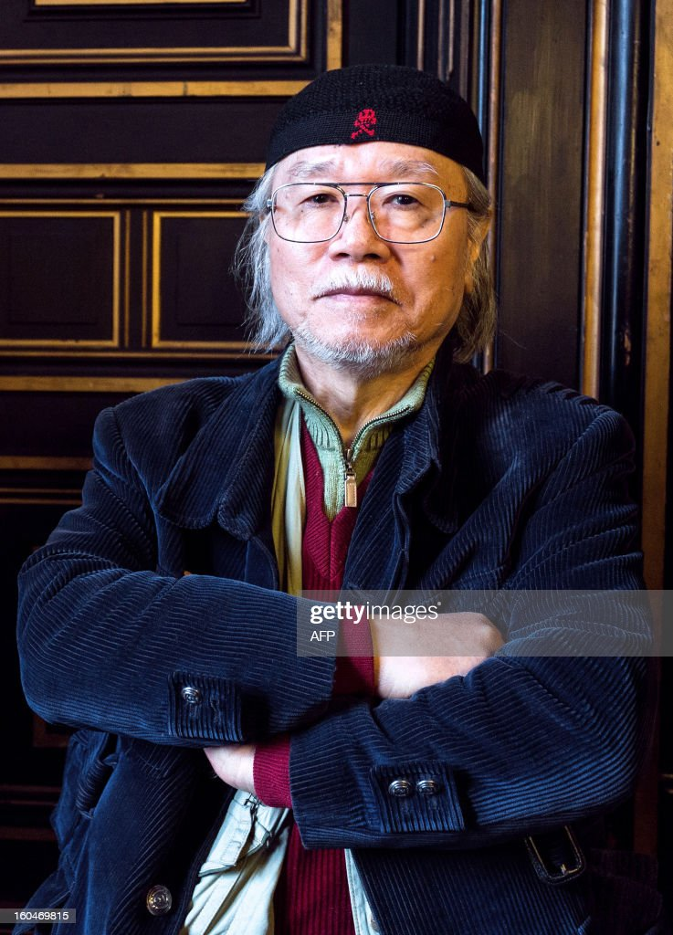 Japanese mangaka Leiji Matsumoto poses on February 1, 2013 during the 40th Festival International de la Bande Dessinée (Angoulene's international comic books festival) in Angouleme, western France. Matsumoto, famous for his series Captain Harlock and Galaxy Express 999, celebrate his 60 years of carreer as the festival's guest of honour today. AFP PHOTO / PIERRE DUFFOUR