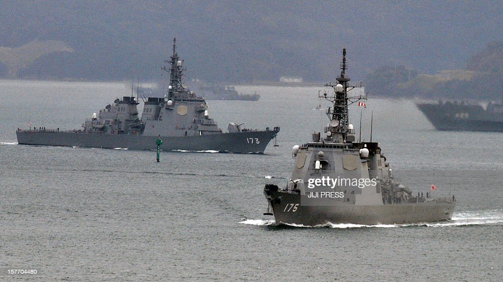 Japanese Maritime Defense Force's Aegis cruiser Myoko (R) and Kongo (L) leave the Sasebo naval base in Nagasaki prefecture to deploy near Okinawa on December 6, 2012. Defence Minister Satoshi Morimoto on December 1 ordered the military to prepare for the North Korea long range rocket launch, ahead of its planned launch this month in defiance of widespread international condemnation, with a defence ministry spokesman telling AFP that 'our ground, marine, and air forces are now preparing to deploy troops in Okinawa', which the rocket may fly over. AFP PHOTO / JIJI PRESS JAPAN OUT