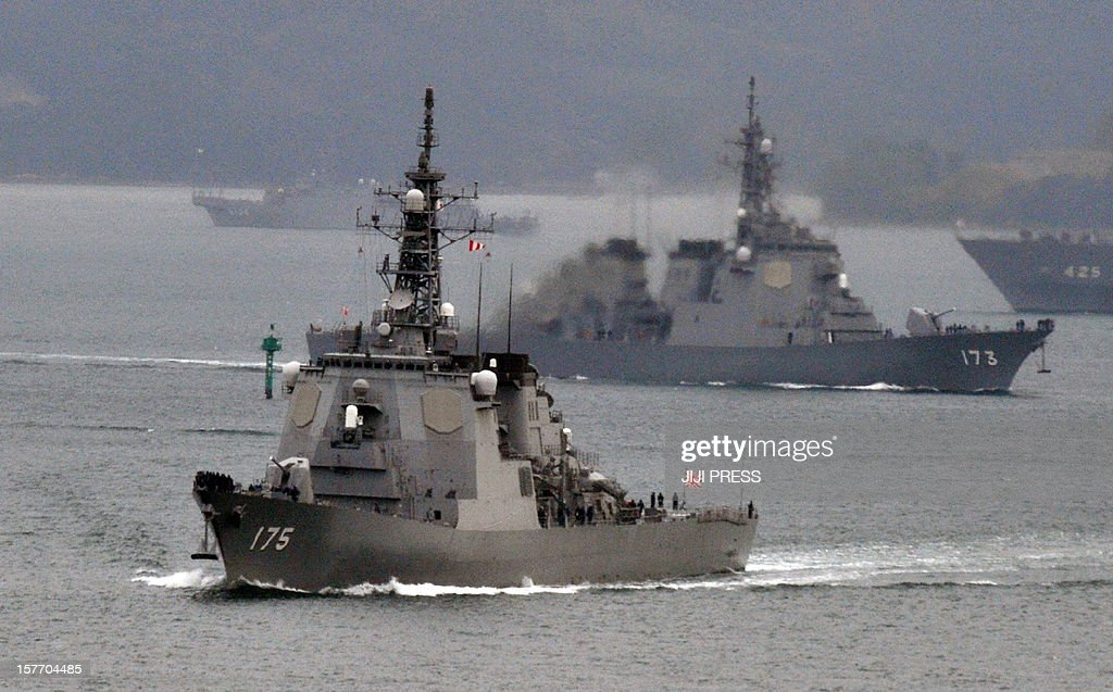 Japanese Maritime Defense Force's Aegis cruiser Myoko (L) and Kongo (R) leave the Sasebo naval base in Nagasaki prefecture on December 6, 2012. Defence Minister Satoshi Morimoto on December 1 ordered the military to prepare for the North Korea long range rocket launch, ahead of its planned launch this month in defiance of widespread international condemnation, with a defence ministry spokesman telling AFP that 'our ground, marine, and air forces are now preparing to deploy troops in Okinawa', which the rocket may fly over. AFP PHOTO / JIJI PRESS JAPAN OUT