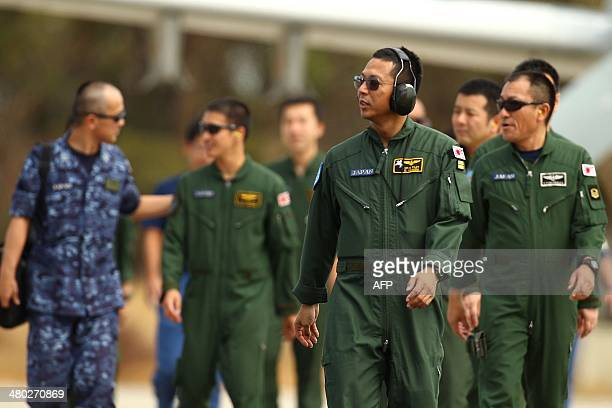 Japanese Maritime Self Defence Force personnel walk from the tarmac as a P3C Orion prepares to depart from the RAAF base Pearce in Bullsbrook 35 kms...