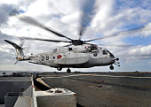 East China Sea, December 5, 2010 09/14/2009 A Japanese Maritime Self09/14/2009Defense Force (JMSDF) MH09/14/200953 Sea Stallion helicopter touches down on the flight deck of the amphibious transport d