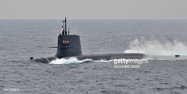 Japanese Maritime SelfDefense Force officers stand guard on the deck of submarine Kenryu during its fleet review off Sagami Bay Japan's Kanagawa...