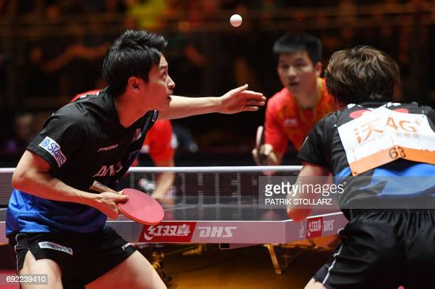 Japanese Masataka Morizono and Yuya Oshima play Chinese Xu Xin and Fan Zhendong during men´s doubles final at the WTTC World Table Tennis...