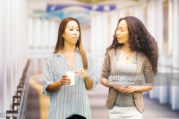 Japanese mature mother listens to her daughter