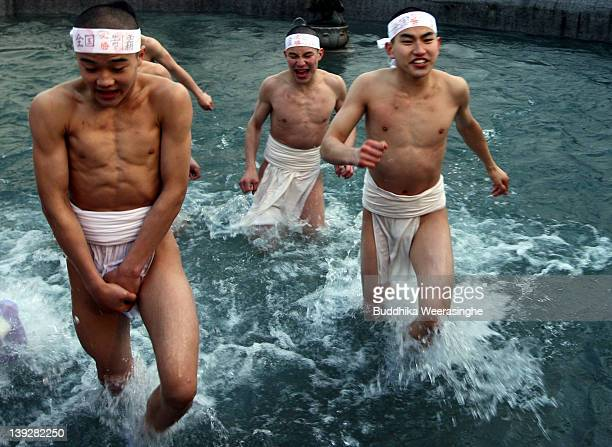 Japanese men wear loincloths as they splash about in freezing cold water during Saidaiji Naked Festival at Saidaiji Temple on February 18 2012 in...