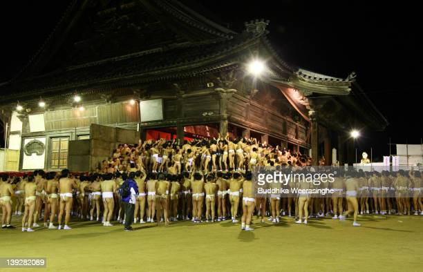 Japanese men wear loincloths as they try to enter the Saidaiji Temple during Naked Festival on February 18 2012 in Okayama Japan Saidaiji Naked...