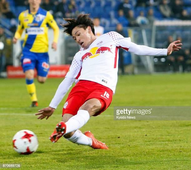 Japanese midfielder Takumi Minamino slides during Salzburg's 31 at St Polten in the Austrian first division on Nov 5 2017 ==Kyodo