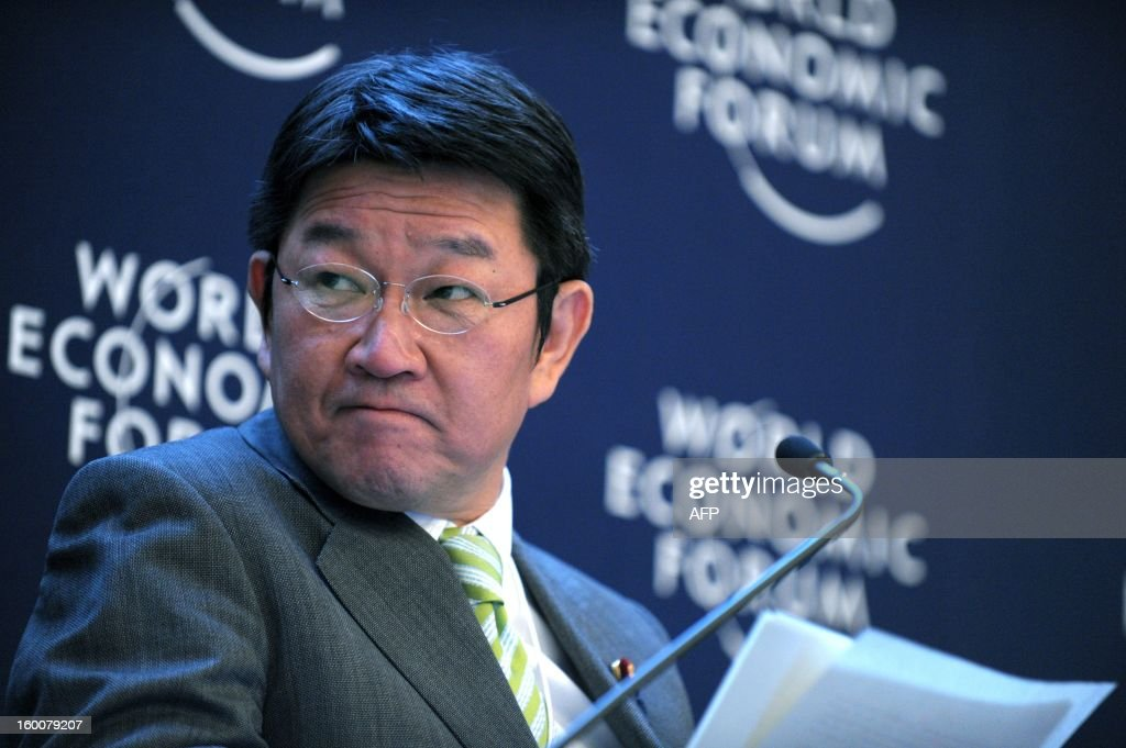 Japanese Minister for Economy, Trade and Industry Toshimitsu Motegi listens during a session at the World Economic Forum in Davos on January 26, 2013. AFP PHOTO / ERIC PIERMONT