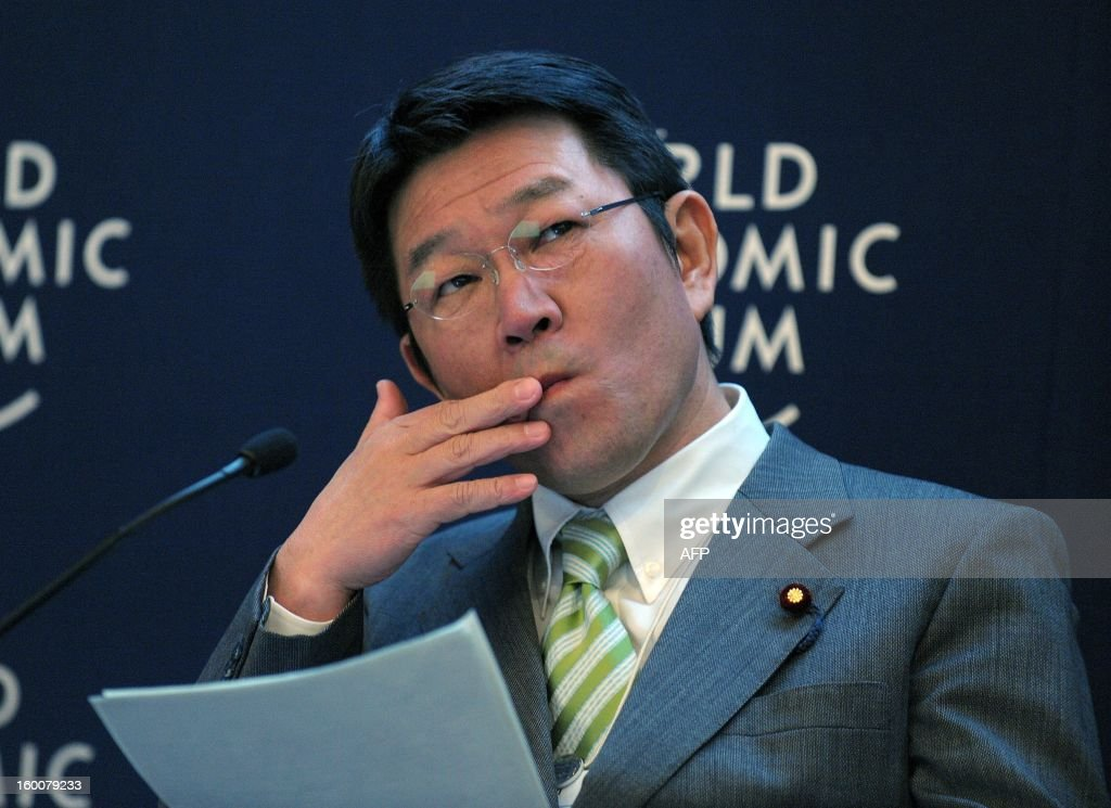 Japanese Minister for Economy, Trade and Industry Toshimitsu Motegi listens during a session at the World Economic Forum in Davos on January 26, 2013.