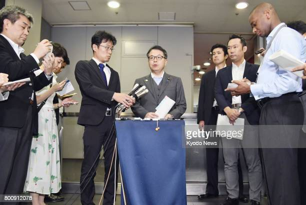 Japanese Minister of Economy Trade and Industry Hiroshige Seko speaks to reporters in Tokyo on June 26 in response to Takata Corp's filing for...