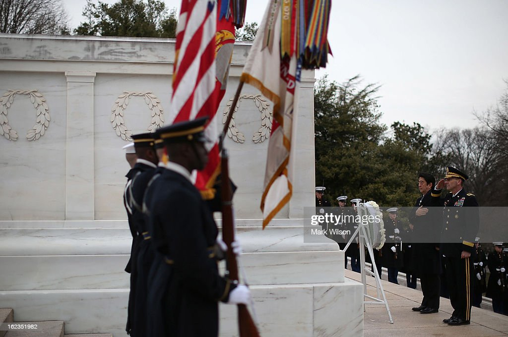 Japanese Minister of Foreign Affairs Fumio Kishida (2nd-R) participates in a wreath laying ceremony at Arlington National Cemetery, February 22, 2013 in Arlington, Virginia. Later today Minister Kishida will meet with Secretary of State John Kerry for a bilateral meeting.