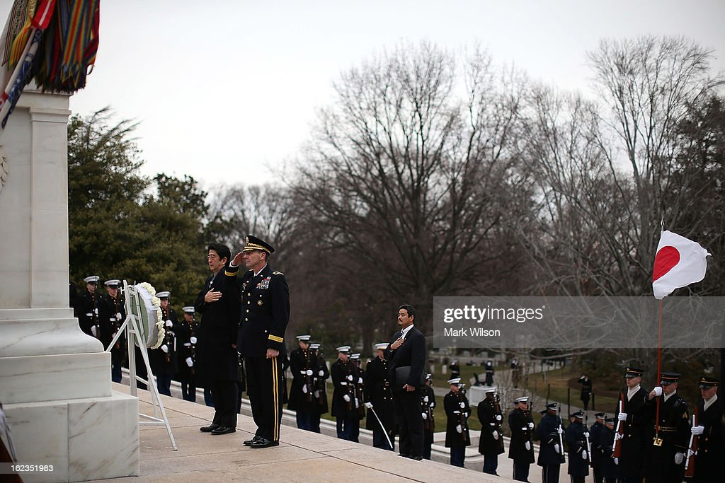 Japanese Minister of Foreign Affairs Fumio Kishida (L) participates in a wreath laying ceremony at Arlington National Cemetery, February 22, 2013 in Arlington, Virginia. Later today Minister Kishida is scheduled to meet with Secretary of State John Kerry for a bilateral meeting.