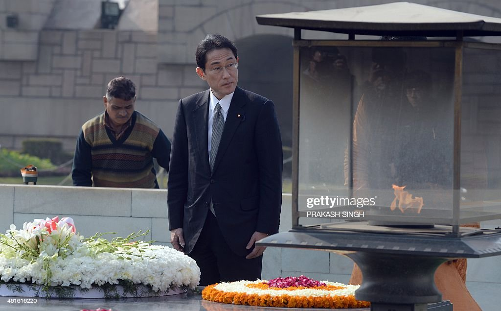 Japanese Minister of Foreign Affairs <a gi-track='captionPersonalityLinkClicked' href=/galleries/search?phrase=Fumio+Kishida&family=editorial&specificpeople=10093794 ng-click='$event.stopPropagation()'>Fumio Kishida</a> pays tribute at Rajghat, memorial for Mahatama Gandhi in New Delhi on January 16, 2015. The Japanese foreign minister is on a three day official visit to India till January 18. AFP PHOTO / PRAKASH SINGH