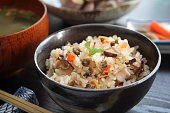Rice seasoned with soy sauce and boiled with Manila Clam, Shiitake mushroom and carrot