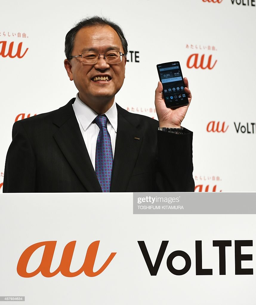Japanese mobile communication giant KDDI president Takashi Tanaka 'isai VL' smartphones one of the company's 2014 winter selection new mobile phone...